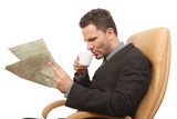 businessman drinking coffee and reading newspaper poster