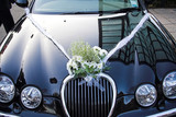 bouquet on wedding car poster
