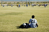 soccer player watching the action. poster