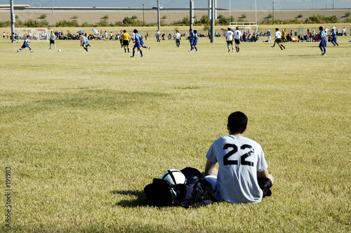 soccer player watching the action.