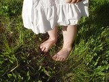feet in grass poster
