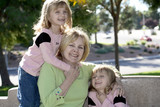 twins hugging grandma poster
