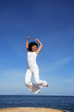 attractive woman jumping poster