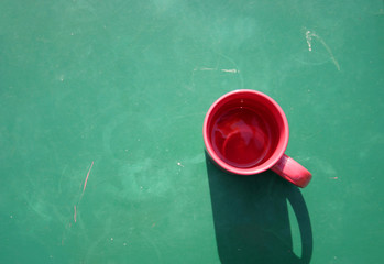 red cup on green
