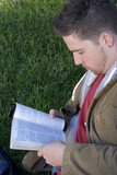 young man reading poster