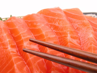 chopsticks and salmon meat