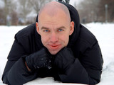 bald young man  on the snow poster