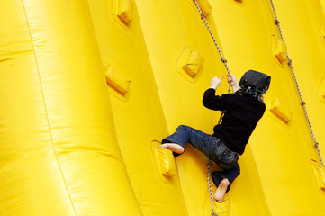 girl climbing on the rubber hill