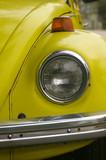 yellow car headlight poster