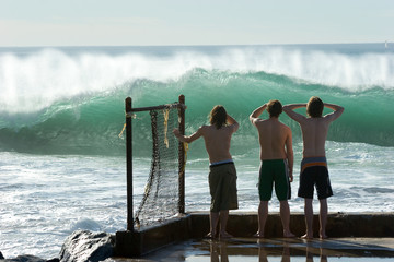 boys checking out the surf