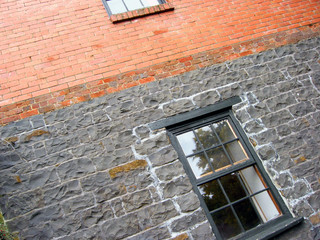 window in a stone and brick building