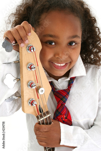beautiful young girl with bass guitar