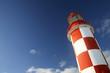 lighthouse under a deep blue sky