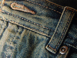 jeans detail - front button and buckle loop poster