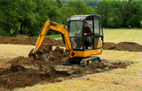 mini digger in action - 250947