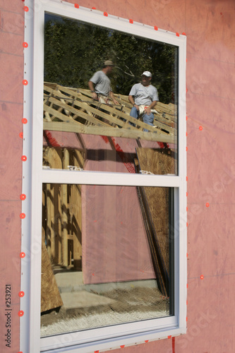 construction workers in window reflection