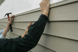 installing siding on a house poster
