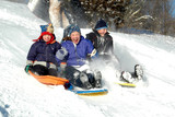 three kids sledding poster