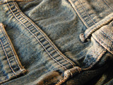 jeans detail - back pocket and buckle loop poster