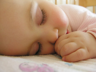 sleeping baby with hand