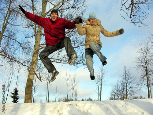 jumping couple . winter.