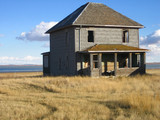 abandoned two story home in saskatchewan poster
