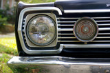 vintage car headlight poster