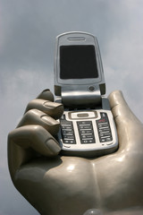 hand and a cellular phone