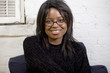 attractive young black woman wearing glasses
