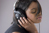 attractive young black woman listening to music on