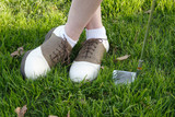 close up of woman wearing golf shoes poster