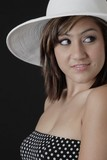cute girl with dimples in white hat poster