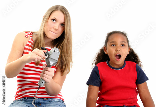 poster of girls playing video game