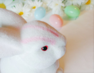 easter bunny delivering colorful easter eggs