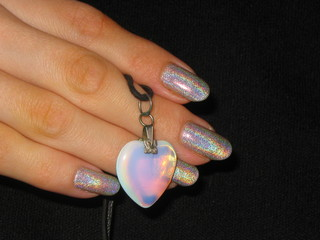 moonstone heart in the hand