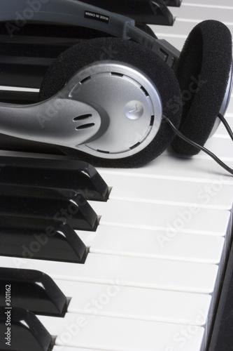 poster of piano headphones