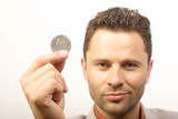 man with one dollar coin poster