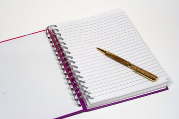 front page of notepad and pen