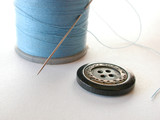 spool of thread with button and needle poster