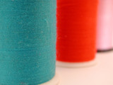 three spools of thread poster