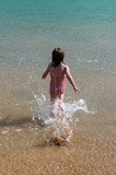 girl running into the water poster