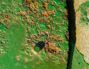 rusting old painted iron plate