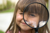 girl with magnifying glass poster