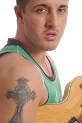 guitarist with large tattoo