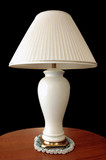 lamp on wood table poster