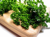 fresh parsley on cutting board poster