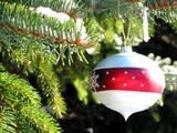 christmas ornament on fir tree poster