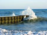 wave splash at the pier poster