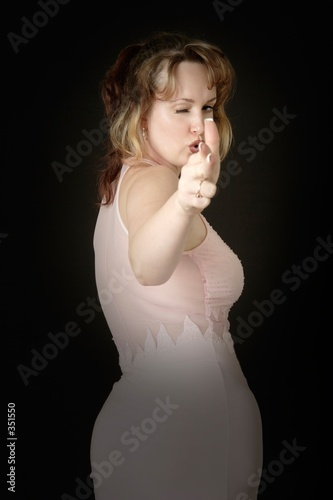 poster of woman pretending to shoot a gun using her hand