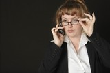 business woman wearing glasses talking on cell pho poster